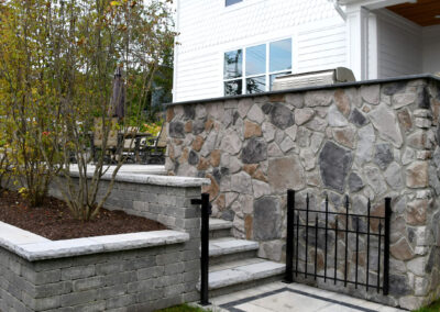 paver steps and stone wall